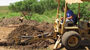 dan operating backhoe